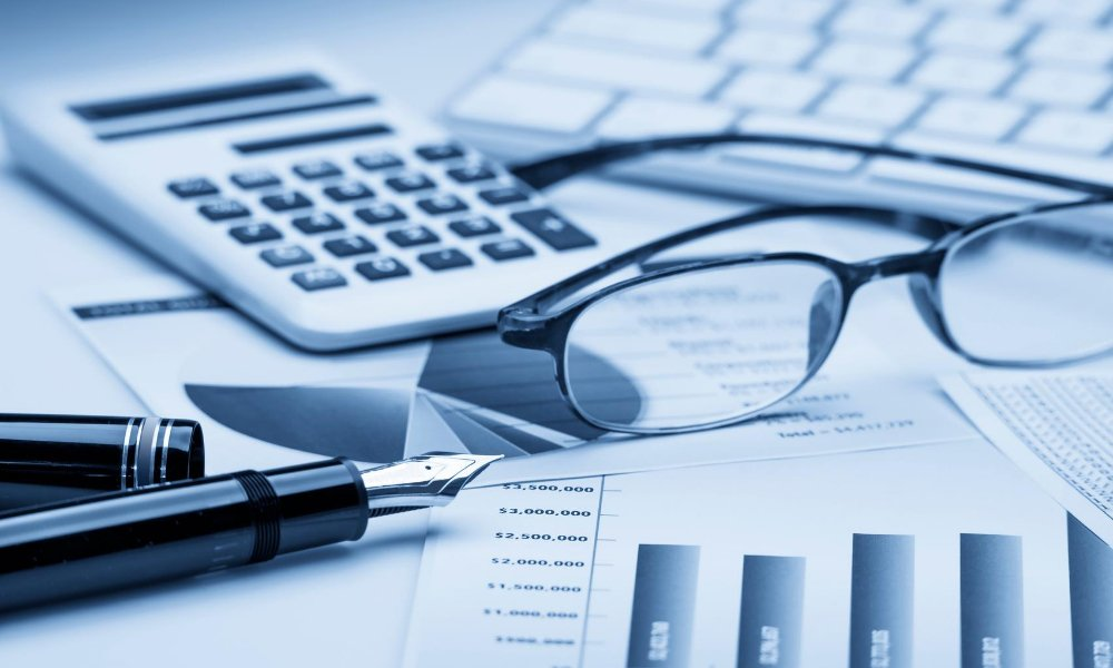 Financial documents and a calculator