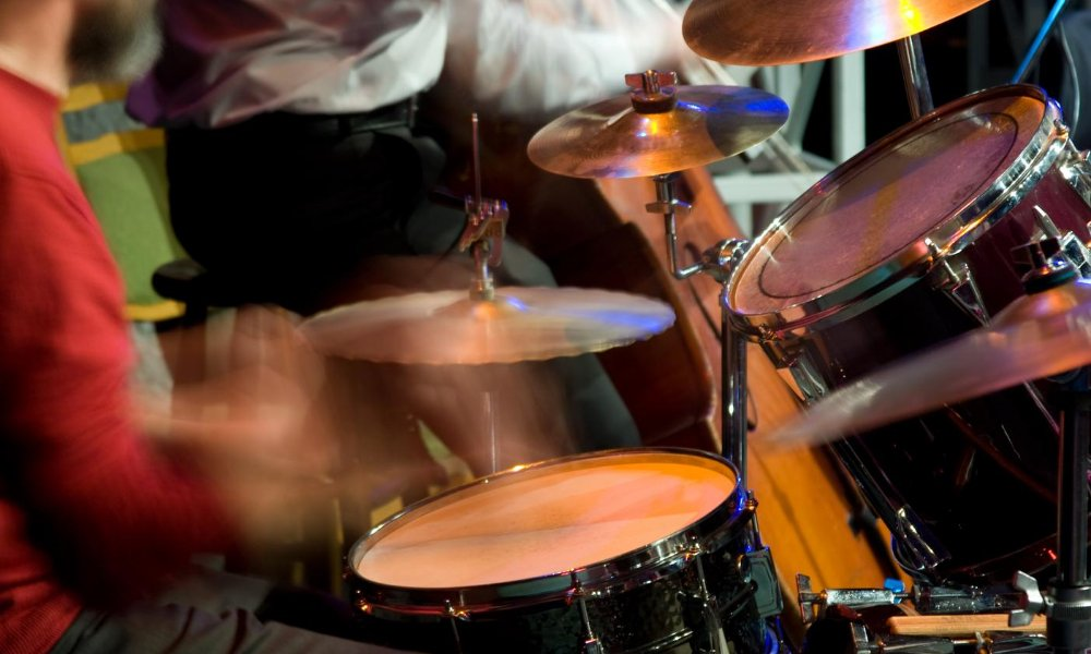 Guy playing drums for live jazz music