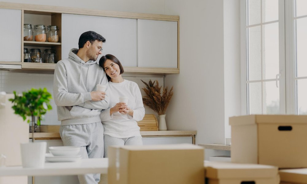 Couple who understand landlord and tenant act in their new apartment
