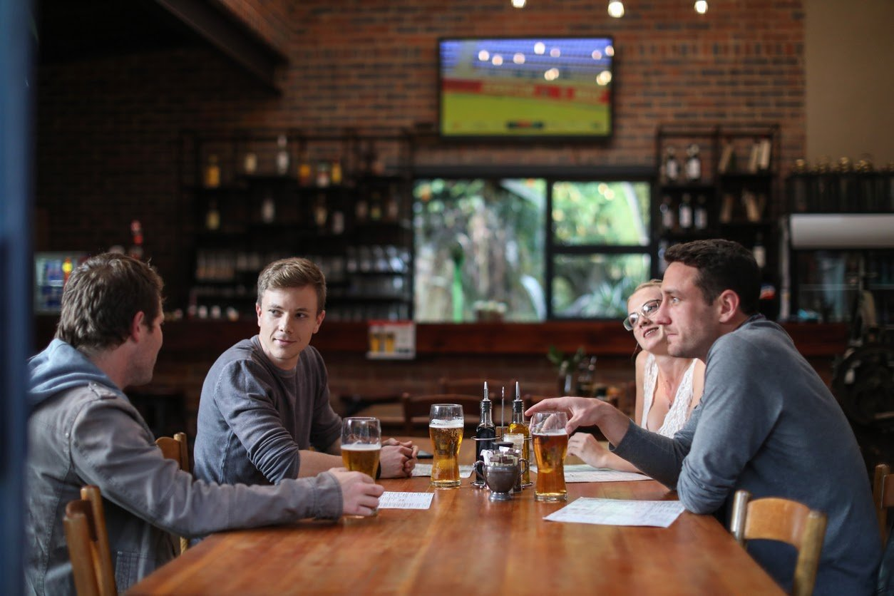 Friends having beers and pizza at one of the sports bars in Rockville Maryland.