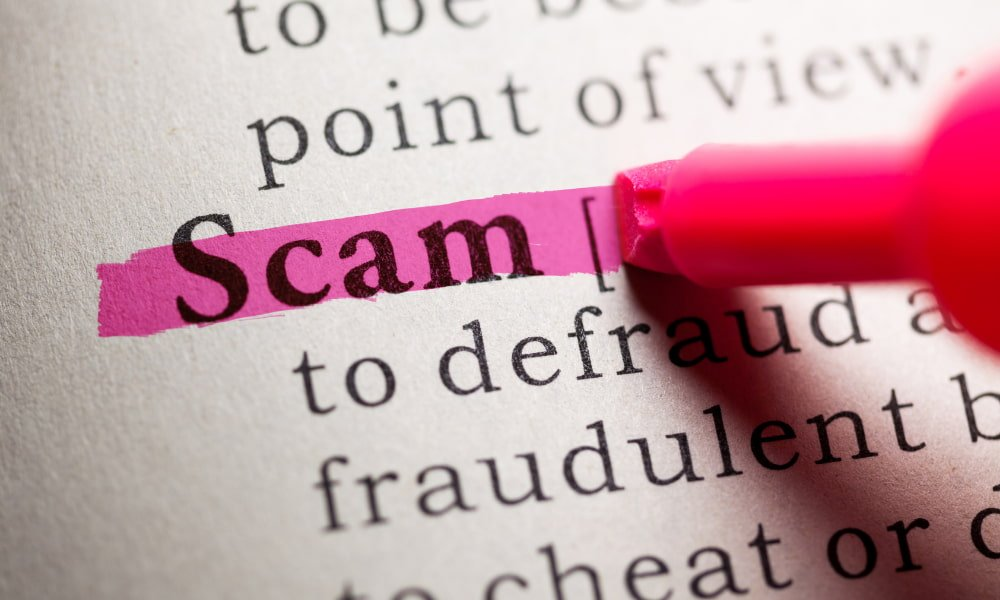 The word scam highlighted in the dictionary by someone researching rental scams.