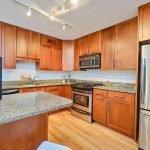 fridge and kitchen area