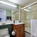 bathroom with shower tub and toilet