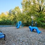 children playground with swings and slide