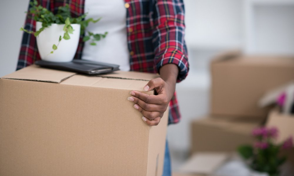 Person moving to rockville holding box