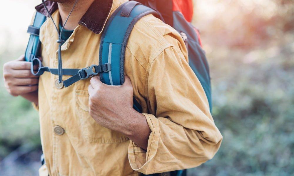 man backpacking on a hiking trail
