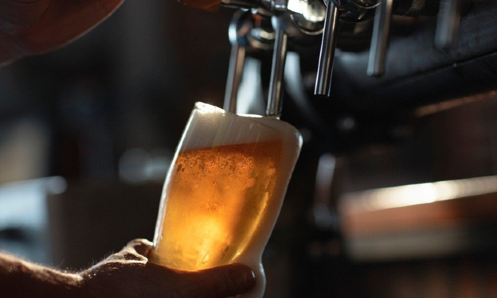 bartender pouring pint of beer at one of the best bars in McLean, VA
