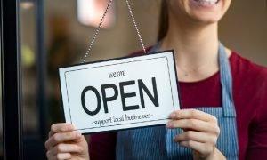 A young woman wearing an apron opens a restaurant near McLean, VA
