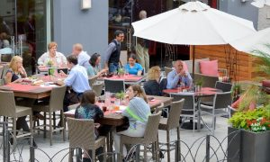 People dining on the patio of a downtown Washington, D.C., restaurant on a nice day.