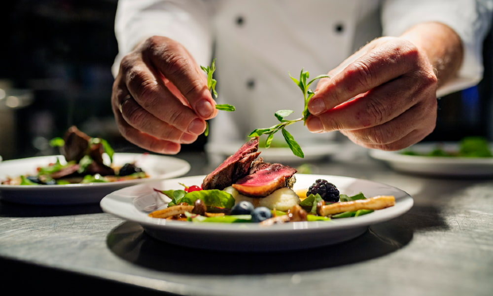 A chef prepares a gourmet meal at one of the many excellent Hyattsville restaurants.