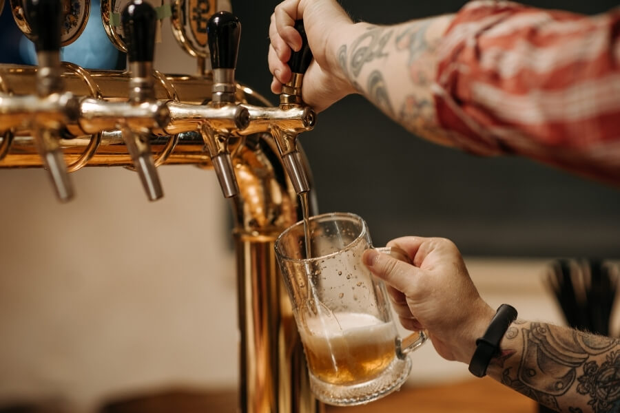guy pouring beer from a tap