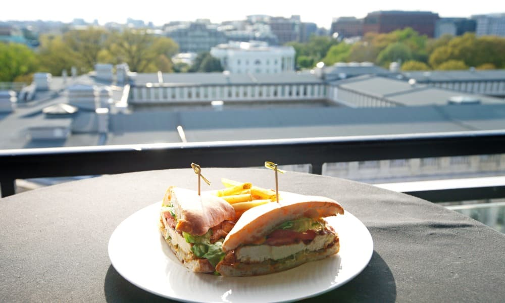 A chicken sandwich plate sits on an outdoor table overlooking the nation's capital, just one of many options for brunch in D.C.