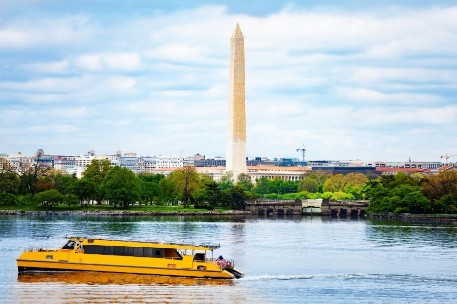 A riverboat in the Potomac River with the Washington Monument in the background