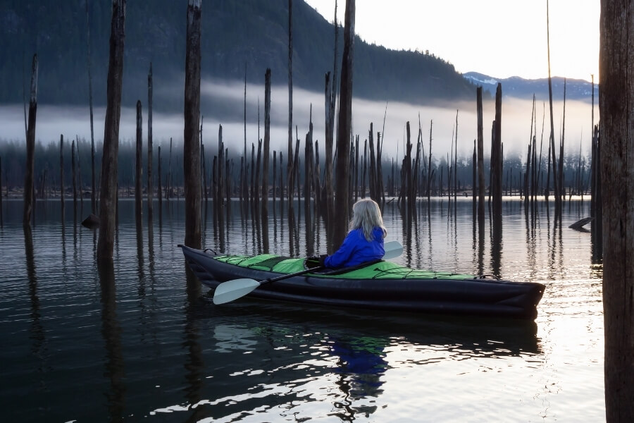 a person enjoying the scenery while kayaking at Lake Accotink