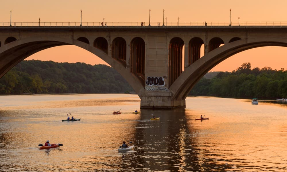 people kayaking in Northern Virginia in the Potomac River at sunset
